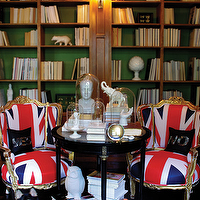 Graham Moss - dens/libraries/offices - gold, French, chairs, union jack, flag, black, accent table, white, black, zebra, rug, glass, cloches, glossy, ebony, wood, floors, built-ins, bookshelves, green, paper, backdrop, Phrenology Head,