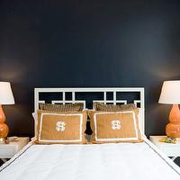 Sally Steponkus Interiors - bedrooms - navy, walls, white, overlapping, squares, headboard, white, hotel bedding, gray stitching, white, x nightstands, orange, gourd lamps, orange, monogrammed, pillows,