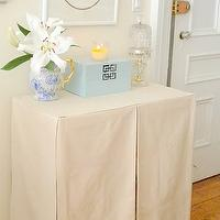 Light and airy foyer design with beautiful skirted entrance foyer table, art ...