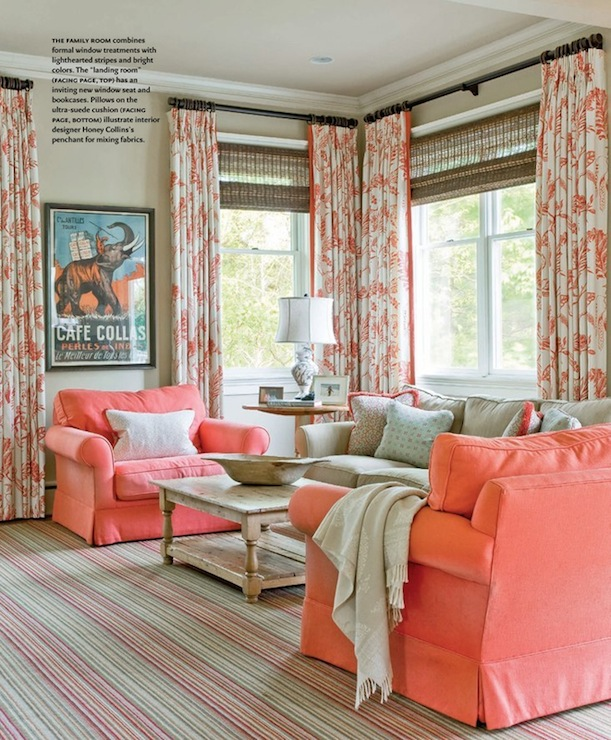 living rooms - woven blinds striped rugs coral upholstery floral print drapes  courtesy of house of turquoise. Aqua blue accents with coral/orange