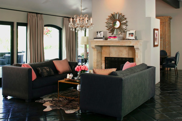 Kishani Perera - living rooms - charcoal, gray, sofas, pink, pillows, white, black, zebra, cowhide, rug, glass, brass, coffee table, limestone, fireplace, silver, sunburst, mirror, crystal chandelier, gray sofa, gray sofas, charcoal gray, charcoal gray sofa, charcoal grey sofa,