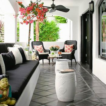 Kishani Perera - porches - covered porch, outdoor furniture,  Chic black & coral deck patio design with glossy white garden stools, white & black