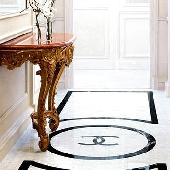 entrances/foyers - chanel logo, chanel, chanel floor, half moon table, demilune table,  Coco Chanel's suite at The Ritz Carlton  via This is