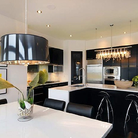 Atmosphere Interior Design - kitchens: kitchen cabinets, linear strand crystal chandelier, kitchen island, white quartz dining table, two tone island, black and white kitchen island, black and white center island, black drum pendant, black leather dining chairs, black kitchen cabinets,