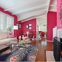 Natalie Umbert - living rooms - peacock rug, peacock feather rug, glass top coffee table, hot pink walls, hot pink wall paint,  Hot pink and