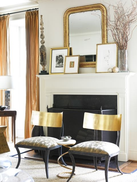 living rooms - gold klismos chairs gray fabric gold mirror gold leaf frames fireplace sisal rug  Courtney Giles  chic living room with gorgeous