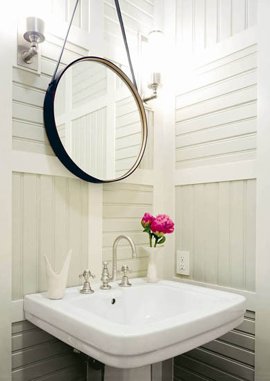 Thom Filicia - bathrooms - Arteriors Expedition Mirror, white, pedestal, sink, sconces, paneled, walls,  Small powder room design with black