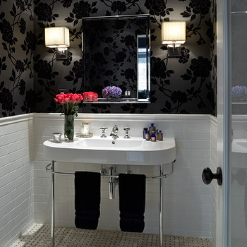 Chair rail in feminine chic bathroom design, glossy black floral wallpaper, subway ...