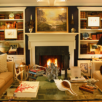 Jean Randazzo - living rooms - navy blue, walls, fireplace, built-ins, bookshelves, cabinets, tan, beige, studded, rolled arm, sofas, nailhead trim, glass, cocktail table, built-in cabinets, built-ins, living room built-ins, white built-ins, white built-in cabinets, built-in bookcase, living room bookcase, fireplace built-ins, fireplace built-in bookcase, fireplace bookcase, floor to ceiling built-ins, floor to ceiling built in cabinets, floor to ceiling built in bookcase,