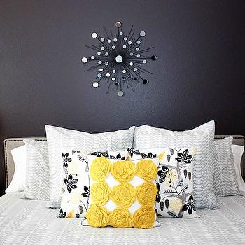 bedrooms - mirror over headboard, mirror above headboard, DwellStudio for Target Pillow,  Yellow and gray bedroom.