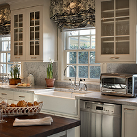 Jean Randazzo - kitchens - glass front kitchen cabinets, black and white roman shades, farmhouse sink, carrera marble, carrera marble countertops, kitchen island with butcher block countertop,