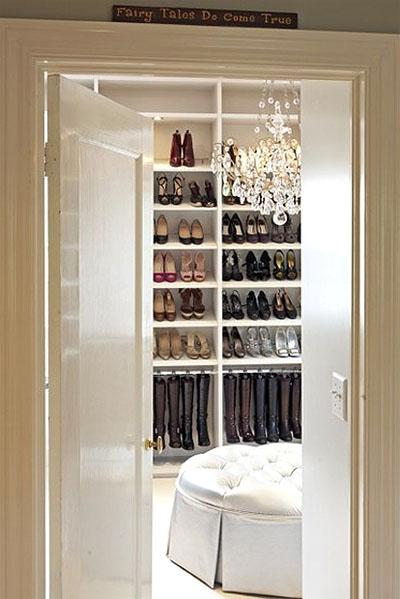 closets - walk-in gray round silk tufted ottoman crystal chandelier shoe rack hanging boot rack  via The Style Files  Dream chic, gorgeous walk-in