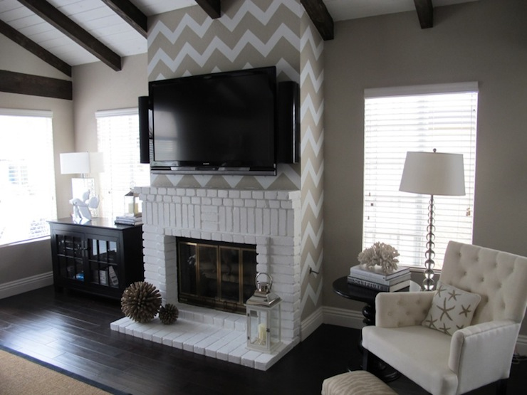 The It Girl Project - living rooms - white, fireplace, TV, herringbone, zig zag, wall treatment, black, cabinet, pedestal table, lantern, ivory, tufted, chair, crystal, floor lamp, wood beams,