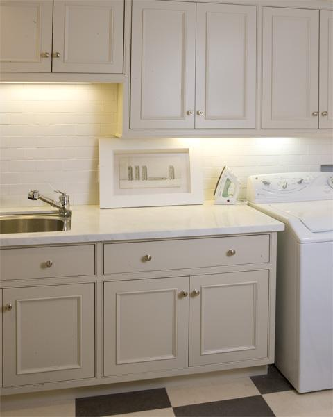 Ivory Laundry Room Cabinets - Transitional - laundry room - Tish
