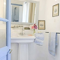 Cote de Texas - bathrooms - white, pedestal, sink, white, washed, mirror, glass bottles, polished nickel, faucet, blue, door, blue, towels,