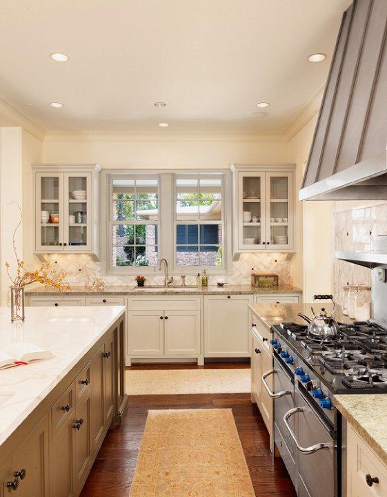 kitchens - gray glass-front kitchen cabinets gray range hood granite countertops gray kitchen island calcutta marble countertops  Dillon Kyle
