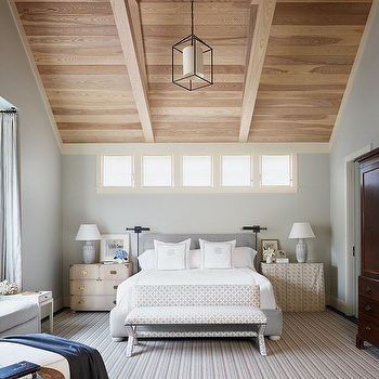 Dillon Kyle Architecture - bedrooms: mismatched nightstands, bedroom with sloped ceiling, sloped ceiling in bedroom, dove gray headboard, campaign chest, skirted table, skirted bedside table, wood plank ceiling,