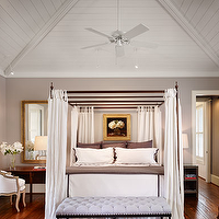 Dillon Kyle Architecture - bedrooms - purple gray paint color, purple gray walls, gray and purple paint color, gray and purple walls, canopy bed, iron canopy bed, bed curtains, bed drapes, bed panels, lilac bench, tufted bench, lilac tufted bench, vaulted ceiling in bedroom, bedroom vaulted ceiling, mismatched nightstands,