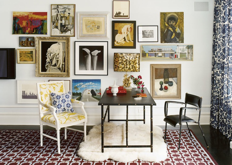Suzie:  Jonathan Adler  eclectic, chic office design with art gallery, black studded iron desk, ...