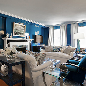 Christina Murphy Interiors - living rooms - lacquer walls, lacquered walls, blue lacquer walls, blue lacquered walls, high gloss walls, blue high gloss walls, indigo blue walls, indigo blue chairs, blue velvet chairs, indigo blue velvet chair, white tufted sofas, sofas facing each other, sofa table,