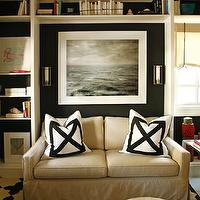 Black & Poole - living rooms - tan, slipcovered, modern, sofa, white, black, geometric, pillows, tan, suede, round, ottoman, pouf, white, black, cross, rug, black, walls, roman shade, white, built-ins, Madeline Weinrib Atelier,