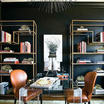 Atlanta Homes & Lifestyles - dens/libraries/offices - lucite desk, lucite desks, porcupine chandelier, porcupine pendant, brass etagere, antique brass etagere, orange chairs, orange leather chairs, shared desk, black walls, black office walls,