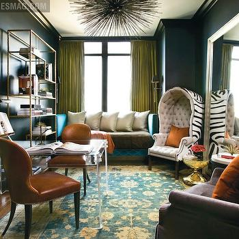 Atlanta Homes & Lifestyles - dens/libraries/offices - lucite desk, lucite desks, porcupine chandelier, porcupine pendant, brass etagere, antique brass etagere, orange chairs, orange leather chairs, shared desk, black walls, black office walls, zebra chair, dome chair, zebra dome chair, turquoise sofa, turquoise blue sofa,