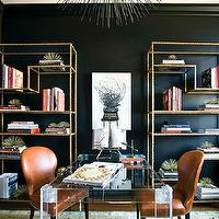 Atlanta Homes & Lifestyles - dens/libraries/offices - black, walls, gold, hollywood regency, bookshelves, acrylic, lucite, desk, table, pumpkin, leather, chairs, nailhead trim, gold, turquoise, blue, rug, black, porcupine, pendant, chandelier, lucite desk, lucite desks,