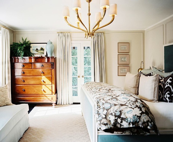 bedrooms - Sandy Chapman Ruhlmann Six Light Brass Chandelier cream walls blue brown bedding tan blue linen pillows blue velvet bed headboard gilt frames french doors blue ginger vase antique chest blue settee