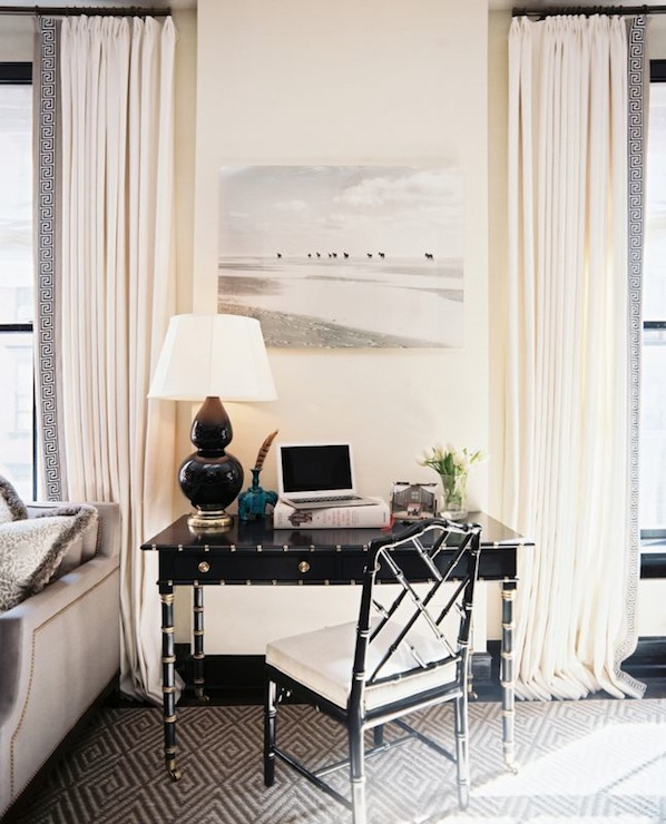 dens/libraries/offices - black moldings glossy black faux bamboo desk gold hardware accents black chippendale chair white tufted cushion seat charcoal gray diamond rug ivory drapes black Greek key ribbon trim