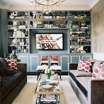Lonny Magazine - living rooms - built-in cabinets, built-ins, living room built-ins, gray built-ins, gray built-in cabinets, built-in bookcase, living room bookcase, built-in media center, built-in media cabinet, built-in tv cabinet, built-in tv center, built-in entertainment center, floor to ceiling built-ins, floor to ceiling built in cabinets, floor to ceiling built in bookcase, sofas facing each other, face to face sofas, gray velvet sofa,