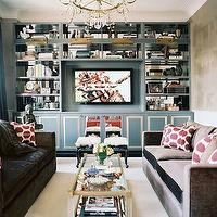 Lonny Magazine - living rooms - charcoal, gray, velvet, modern, sofas, hot pink, ikat, silk, pillows, mirrored, coffee table, glossy, blue, stools, blue, built-in, media unit, TV, buddha, blue, silk, drapes, built-in cabinets, built-ins, living room built-ins, gray built-ins, gray built-in cabinets, built-in bookcase, living room bookcase, built-in media center, built-in media cabinet, built-in tv cabinet, built-in tv center, built-in entertainment center, floor to ceiling built-ins, floor to ceiling built in cabinets, floor to ceiling built in bookcase,
