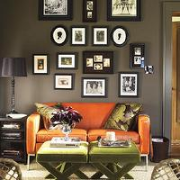 Elle Decor - living rooms - dark, gray, walls, orange, leather, modern, sofa, green, velvet, x, stools, ottomans, green, brown, floral, silk, pillows, black, lamp, silhouette, art, eclectic, art gallery, sisal rug,