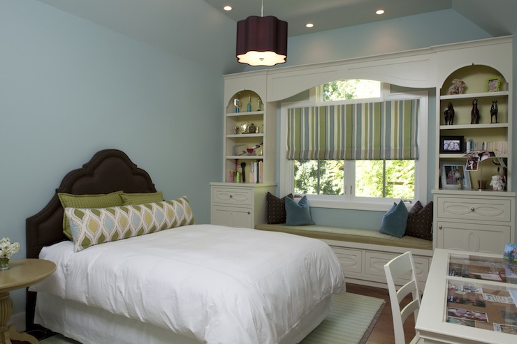 girl's rooms - glass-top desk chocolate brown headboard green blue pillows white built-ins window seat green cushion green blue striped roman shade blue walls ceiling