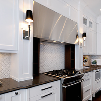 Chic white kitchen design with white Ikea kitchen cabinets, basketweave marble tiles ...