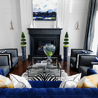 Atmosphere Interior Design - living rooms - blue sofa, blue velvet sofa, blue couch, blue velvet couch, zebra cowhide rug, glass and nickel coffee table, glass top coffee table, glass topped coffee table, barrel back chairs, indigo blue sofa, indigo blue velvet sofa,