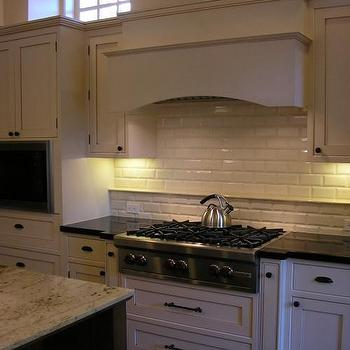 Design Moe - kitchens - beveled subway tiles, beveled subway tile backsplash, paneled range hood, two tone countertops, black countertops, granite countertops,