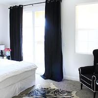 Made by Girl - bedrooms - white, slipcovered, headboard, black, striped, shams, white, black, silk, lattice, pillows, black, drapes, square, mirrored, nightstand, mirrored, accent table, black, wingback, chair, white, piping, white, black, cowhide, rug,