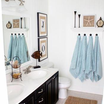 Just a Girl - bathrooms - Benjamin Moore Cotton Balls, Beadboard, Wainscoting, blue ceiling, black cabinets, framed mirror, jute rug, towel rack, black double vanity, black double bathroom vanity, beach cottage bathroom,
