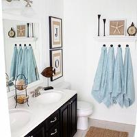 Just a Girl - bathrooms - Benjamin Moore Cotton Balls, Beadboard, Wainscotting, blue ceiling, black cabinets, framed mirror, jute rug, towel rack,