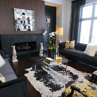 Atmosphere Interior Design - living rooms - charcoal, gray, sofas, yellow, gray, pillows, white, blacl, cowhide, rug, barcelona, coffee table, black, glass tiles, fireplace, white, porcelain, dog, statues, gray, drapes,