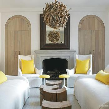 Atlanta Homes & Lifestyles - living rooms - yellow pillows, yellow accents, yellow room accents, canary yellow pillows, white sofa with yellow pillows, white chair with yellow pillows, arched doors,