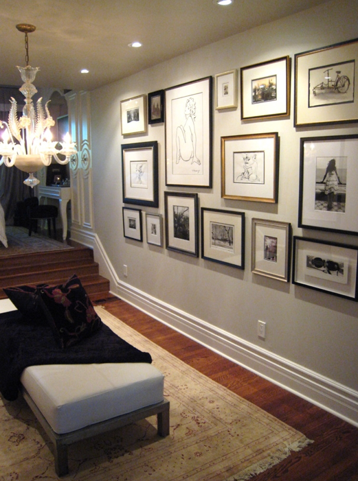Suzie:  Meredith Heron  Beautiful foyer design with eclectic photo art gallery, chandelier, ...