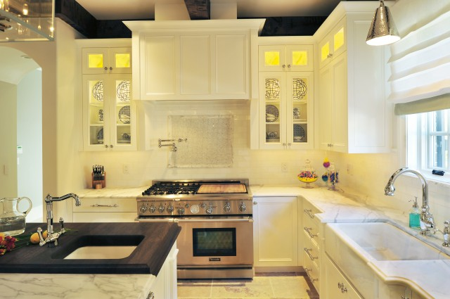 Beckwith Interiors - kitchens - Benjamin Moore - Calm - two tone countertops, island with two countertops, white kitchen cabinets, glass front kitchen cabinets, calcutta marble countertops, calcutta marble backsplash, paneled range hood,