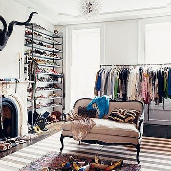 closets - shoe racks, clothes rack, french settee, striped rug, white and gray striped rug, white and gray rug, closet with fireplace, walk in closet fireplace, closet fireplace, bedroom converted to closet,