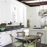 Brian Watford Interiors - kitchens - eat in kitchen, eat in kitchen ideas, white kitchen cabinets with black countertops, two tone countertops, island cooktop, cooktop on island, cooktop on kitchen island, industrial pendants, , Restoration Hardware Benson Pendant, Restoration Hardware Madeline Chair,