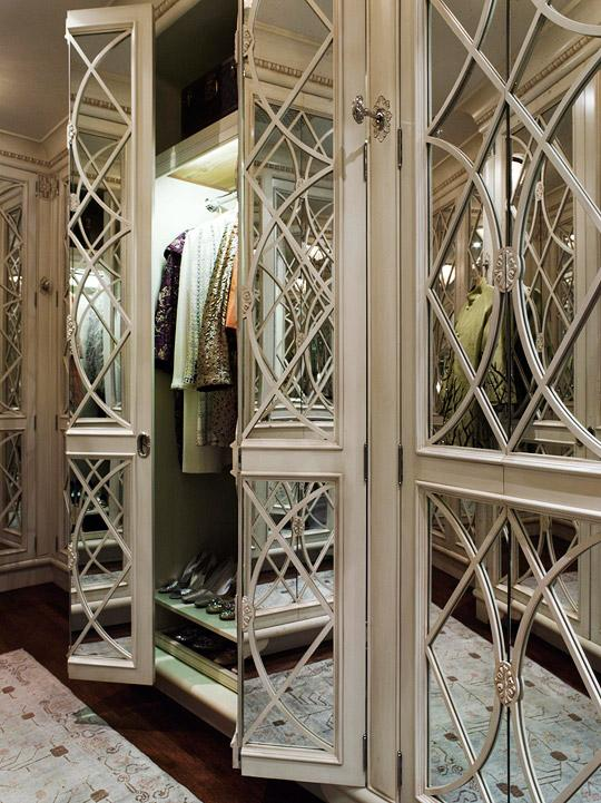 closets - walk-in mirrored doors shoe shelves  Beaux Arts Mansion  Traditional Home Mag  Chic closet with mirrored doors and shoe shelves.