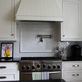Classic white kitchen design with white Ikea kitchen cabinets, black granite ...