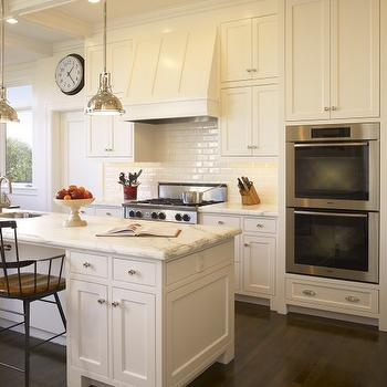 Gast Architects - kitchens - shaker cabinets, shaker kitchen cabinets, paneled range hood, subway tiled kitchen, calcutta gold marble, calcutta gold marble countertop, harmon pendants, white kitchen island, double ovens, Restoration Hardware Harmon Pendant,