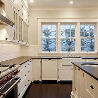 Paul Moon Design - kitchens - gray, walls, white, glass-front, kitchen cabinets, oil-rubbed bronze, pulls, hardware, honed, black, granite, countertops, round, sink, farmhouse, sink, pot filler, glossy, beveled, subway tiles, backsplash, Benjamin Moore Cloud White, Wolf Range,